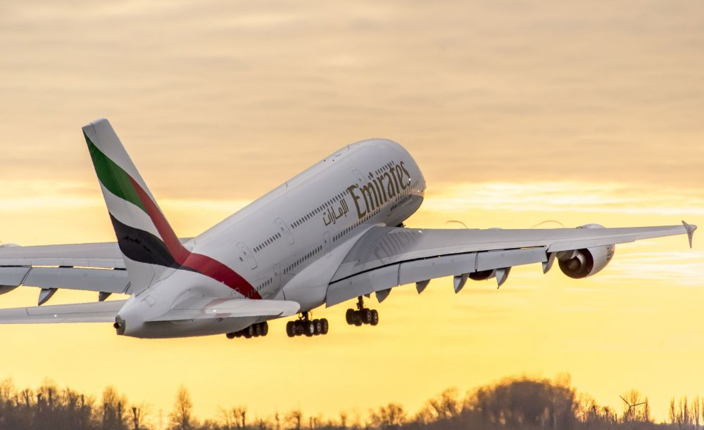 PHOTO-Emirates-A380-taking-off-sunset.jpg